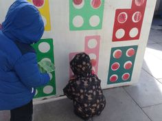 My team made a large Numicon board for outside. The children often match the large Numicon to this. Here they were adding large coins to the holes.