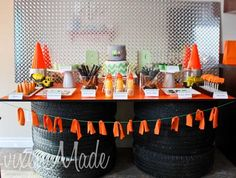 Construction Table (Spaceships and Laser Beams): Use tires and piece of wood to prop up food table at construction / truck / car / Hotwheels / racecar / transportation / monster truck party