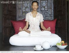 Tranquil meditation spot. Especially love the wall behind her.