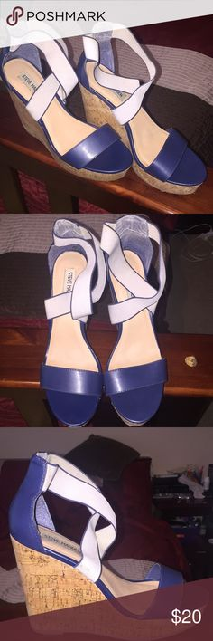Blue wedges Gently used. My foot got smaller and they don't fix anymore. Steve Madden Shoes Wedges