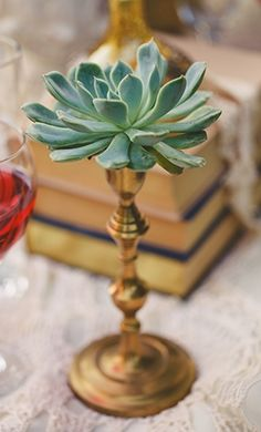 Succulent candlesticks, perfect table decor! (Photo by Tyler Rye Photography via Inspired By This)