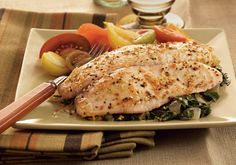 Doctors may encourage you to eat more fish, but your stomach will inspire you to prepare the Baked Tilapia With Garlic and Herb Oil. From the sea to your plate, this trouble-free preparation includes fresh spinach and Dash™ Garlic & Herb Seasoning Blend. Tilapia Recipes, Fish Recipes, Seafood Recipes, Cooking Recipes, Top Recipes, Meal Recipes, Fish Dishes, Seafood Dishes, Main Dishes