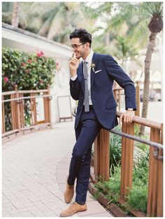 Groom style: Modern navy pinstripe suit by J.Crew, image by Gianny Campos Photography.