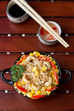 Sweet corn gives a sweet flavor whereas the chilies and sauce gives a nice hot and tangy flavor. Sweet Corn Fried Rice Recipe made quickly. Rice Recipes, Asian Recipes, Ethnic Recipes, Rice Bowls, Rice Dishes, Chinese Spices, How To Boil Rice, Food Therapy, Sweet Corn