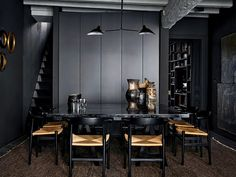 Crisp Masculine Dining room. dark mood with  rustic chairs and black contemporary lighting