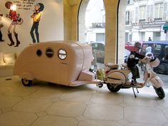 One of the signatures of Bonpoint's flagship in Paris is a little pink caravan (trailer or camper for we Americans) pulled by a Vespa. It's one of the cutest store windows out there. But the question on the lips of many is where can the cute little trailer be found. It is made by a British company, Pod Caravans, and comes in a whole range a pastel colors. And the best thing, it's a functioning trailer that sleeps two. Prices start at 6000GBP.