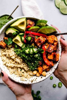 This Buddha Bowl is topped with roasted sweet potatoes, peppers and chickpeas and drizzled with a tangy green mojo sauce. It's a healthy (vegetarian + vegan) dinner or lunch. #buddhabowl #vegetarianrecipe #veganrecipe