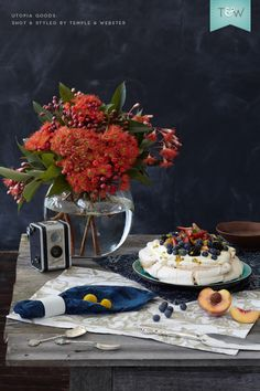 Utopia Goods table linen for Australia Day, with flowering gum and a pavlova. Photo by Denise Braki,  styling by @Adam Powell  for Temple & Webster