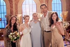 Pheobe's wedding in the last ever charmed episode. Piper, Pheobe, The angel of destiny, Coop (Pheobe husband, the cupid) and Paige.