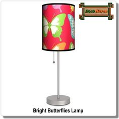 Bright Butterflies Lamp - Bright colors and dazzling light will fill your room when you pull the stainless steel cord of this lamp. The slim design makes it a perfect fit for any table or desk, and the butterfly-adorned shade is cheery and charming.