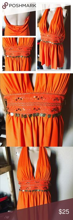 🌼GYPSY BOHEMIAN HALTER🌼 ⭐️⭐️⭐️GYPSY HALTER⭐️⭐️⭐️beautiful burnt orange 🍊 boho gypsy halter, stretch material, ties around the neck with an open back ! Has gold accents and beading underneath the breast area ! Can be worn with out a bra because the material is thick enough to cover! Tag says size small , but it actually will fit a medium not a small! Very very cute top! Pairs great with anything and can be dressed up or down for multiple occasions. Bright like the sun ☀️ perfect for the…