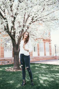 white blouse and black denim jeans