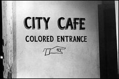 """Seperate """"white"""" and """"colored"""" entrances to the cafes."""