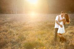 photo by Los Angeles wedding photographer Roberto Valenzuela - fun engagement photo of couple embracing in open field