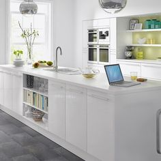 These high gloss white kitchen units are perfect for a streamlined minimal kitchen scheme. Try combining them with sleek stainless steel appliances and designer pendant lights help to create a high spec look on a limited budget.