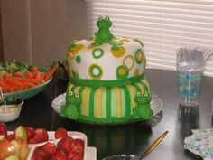 Frog Cake:  I used fondant.  I cut out circles with a fondant circle cut out set.  I cut out one inch stripes out of different colored fondant and then alternated