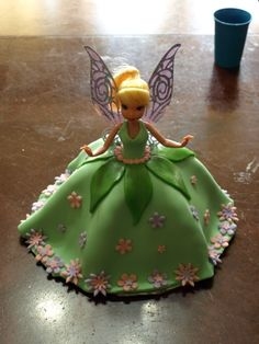 Tinkerbell - This was a birthday cake for my daughter. Funfetti cake with Tinkerbell doll. The dress, leaves and flowers are fondant. The inspiration came from another member. Tinkerbell Birthday Cakes, Tinkerbell Doll, Tinkerbell Party, Tangled Party, Princess Birthday, 2nd Birthday, Barbie Cake, Disney Cakes, Novelty Cakes
