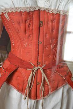 "Original label: ""platt hall."" Perhaps taken at Platt Hall. The original orange corset is in the collection of the Manchester City Galleries."