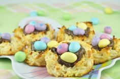 """Coconut Nutella Macaroon Nests recipe for Easter or Spring. This was my first attempt at macaroons and I was surprised how easy they were. I added Easter M and M's as the """"eggs"""". How cute are these??"""