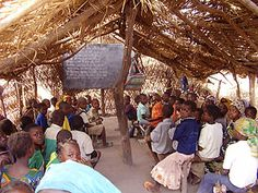 Students at the Koumra School in rural Chad (a country in central Africa) attend class in a palm-leaf-covered hut. The lack of safe, cheap lighting in their country makes completing homework assignments at night difficult. Schools Around The World, Around The Worlds, Cheap Lighting, Cultural Diversity, Great Photos, Old And New, Social Studies, Geography, Culture