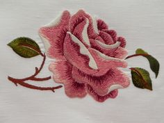 Machine embroidery satin stitch rose.