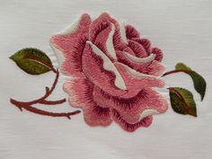 Machine embroidery satin stitch rose.