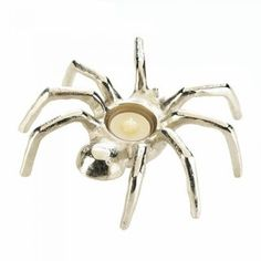 """Spider Candleholder by Taylor Made Events For You You wont regret inviting this spider to your table! Made from aluminum, this tabletop candle holder is shaped like a fun and friendly arachnid. Perfect for Halloween, but sleek and stylish enough to have on display all year long! Candle not included.Material(s): ALUMINUMWeight 1 poundDimensions 7.5"""" x 7"""" x 2.25"""""""