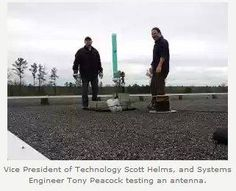 Scott and Tony P. testing an antenna on top of our Gordon call center during white space testing trial.