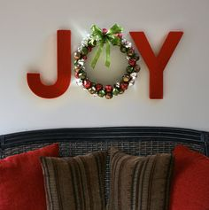 Painted letters from a craft store and a jingle bell wreath.