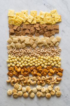 I do love my Snack Mix. Mine contains: Rice Chex, Corn Chex, Pretzel Sticks, Cheez-Its, Cheerios, Cheese flavored Baby Goldfish, Mixed Nuts, and Cheetos, all mixed together in a large roasting pan, and drizzled with a sauce made from melted Butter, Worcestershire Sauce, Seasoned Salt, and Garlic Powder. Bake at 250 degrees for an hour, turning every 15 minutes. Bag up in four or five large ziplock bags, and keep hidden around the house. Eat as needed.  ~~  Houston Foodlovers Book Club