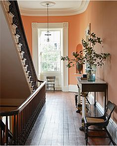 Gil Schafer, Charleston.  hall is painted in Rhett Pumpkin, from the Colors of Historic Charleston collection.