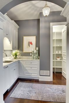 Dior Gray 2133-40 by Benjamin Moore against white cabinetry looks beautiful! Dior Gray is part of Color Preview. A collection of bold, saturated colors that brings spaces to life for those looking to illuminate their world with pure, extraordinary color.
