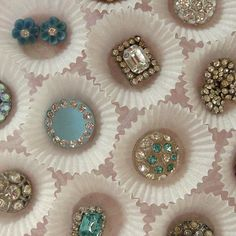 Vintage rhinestone buttons (by fancylinda via Flickr) ... Displayed in mini cupcake liners ... interesting.