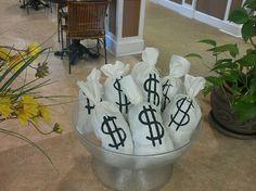Money bag decor for roaring 20's speakeasy made by seniors.