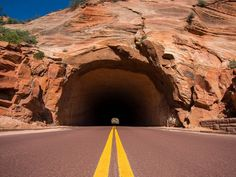 """One of the nation's most scenic tunnels can be found in Utah. The Zion-Mount Carmel Tunnel on the highway between Zion National Park and Bryce Canyon National Park includes a series of """"windows"""" in the sandstone walls, allowing drivers to look out over some pretty spectacular vistas. Don't forget to watch the road!  Flickr/Bryan Ungard"""