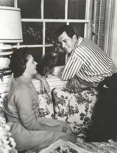 Rock Hudson being kissed by his poodle Demi