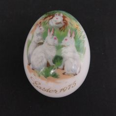 "This is a 1975 collectible porcelain Easter egg by Royal Bayreuth of Germany SCENE: 4 rabbits in various poses on grass and flowers, blue sky. SIZE: 3"" x 2"" x 2"". 