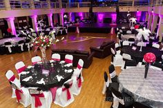 Kim Moody Design. Wedding Planning, Event Management, Floral Design.  Virginia Weddings.  www.kimmoodydesign.com   Pink lighting.  Black white fuschia pink reception