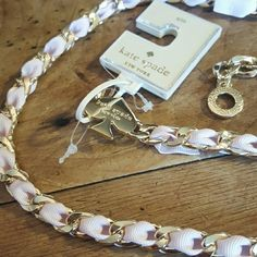Kate Spade chain belt.  Price firm Gold chain with pink ribbon.  Super cute! NWT kate spade Accessories Belts