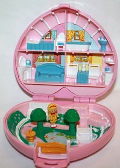 Polly Pocket! I had like a million of these things! I would love to have them again for Marley to play with.