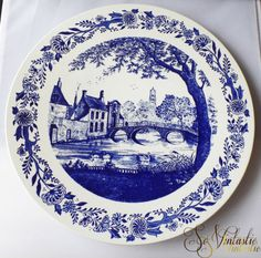 A MINT vintage Boch Belgium XL wall hanging plate in Delft Blue. Boch Freres Keramis, Boch la Louviere. Blue transferware. A very decorative, vintage charger, cobalt patterned, showing a scene of an old village with water, swans, an old bridge, a distant church, trees and old buildings, by SoVintastic, € 24,95 only