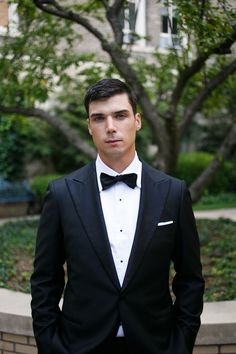 classic black tuxedo | groom in bow tie | Photography: Azuree Wiitala - www.xoazuree.com/  Read More: http://www.stylemepretty.com/2014/10/23/classic-chicago-black-tie-wedding-at-rivers-restaurant/