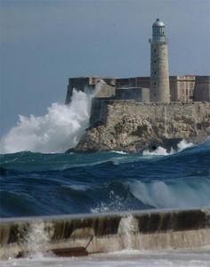 Morro lighthouse on the Malecón (officially Avenida de Maceo) along the coast of Havana, Cuba.