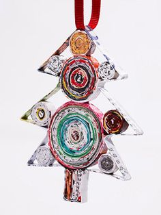 Recycled Magazine Ornaments on http://www.lhj.com/volunteering/holiday-gift-guide-2009-charity-presents/
