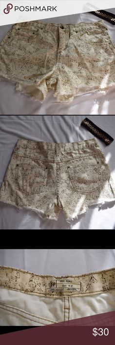 Free People Distressed Shorts Size 27! Excellent condition. Distressed look. Only been worn once. Cute design print. Free People Shorts Jean Shorts