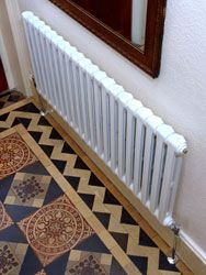 Clasico 2 white columns radiator attached to the wall. Let´s Recoupage old cast iron radiators.