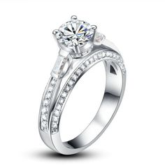 Set in Platinum, De Raffinato engagement ring, demonstrates superbly, the magnificent fire and brilliance of all the surrounding diamonds. The elevated 0.50 carat central stone follow as side stones, 2 baguette cut & 70 pavé set diamonds, all in SI1-2 clarity and in H color. All creations are certified by reputable gem-laboratories.