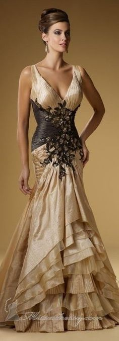 Gorgeous gold and black gown - love the floral details and the sexy silhouette