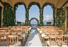 Villa del Balbaniello Loggia # Amazing ceremony setting # wedding arch , White aisle and hydrangea flowers on the parigina chairs # beautiful wedding venue on Lake Como