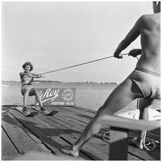 Henk Jonker. Woman gets lesson in water skiing, 1953 [source]